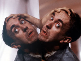 Surrounded by heads  (Terry Gilliam's Brazil)